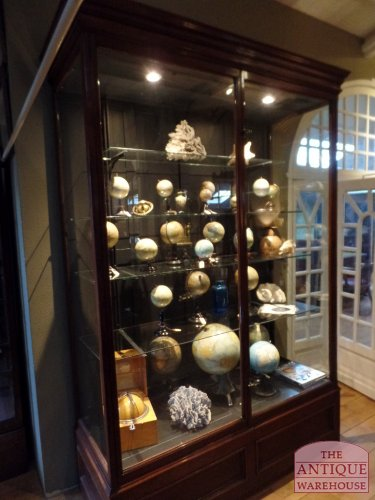 antique showcase with globe's